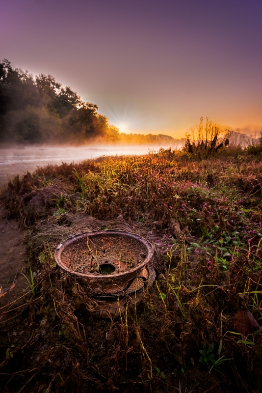 An old wheel washed up on a Potomac River island.